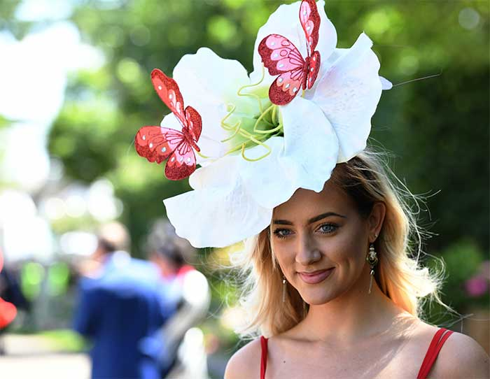 Harriadnie Beau wearing a Alyce Paris dress and a Ilda Di Vico Couture Millinery hat covered in butterflies attends Ladies Day at Royal Ascot on June 21, 2018.