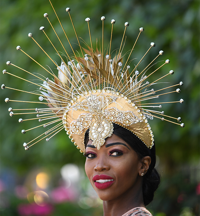 Model Lystra Adams in a golden hat attends Ladies Day at Royal Ascot on June 21, 2018.