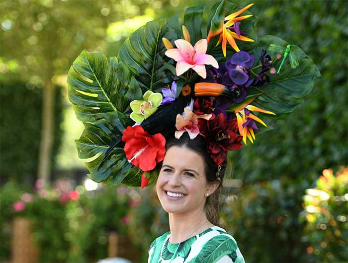 Charlotte Ricard-Quesada poses for photographers in a flowery hat attends Ladies Day at Royal Ascot on June 21, 2018.