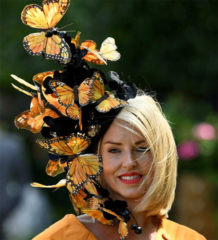 A racegoer in a hat covered in butterflies attends Ladies Day at Royal Ascot on June 21, 2018.