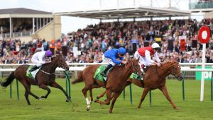 Summer Sands (left) finishing a shock third behind Earthlight and Golden Horde in the Middle Park Stakes at Newmarket