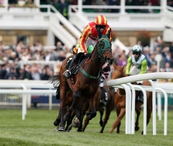 Top Ville Ben ridden by Sean Quinlan during the first lap of the Betway Mildmay Novices' Chase during Ladies Day of the 2019 Randox Health Grand National Festival at Aintree Racecourse.